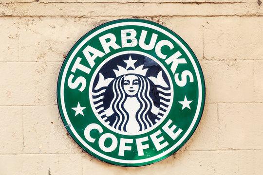 Starbucks Coffee metal logo sign on wall