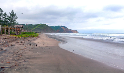 Lateral view of the Ayampe fishing beach, early in the morning on an overcast day. Ayampe, Manabi, Ecuador