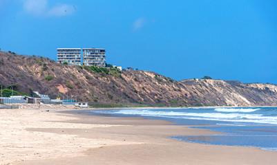 Beautiful beach on a sunny day, with people, birds and para-gliders. San Pedro, Manabi, Ecuador