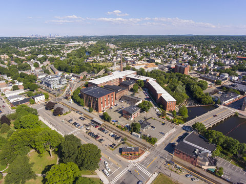 Waltham city center and historic Francis Cabot Lowell Mill next to Charles River aerial view in downtown Waltham, Massachusetts, MA, USA.