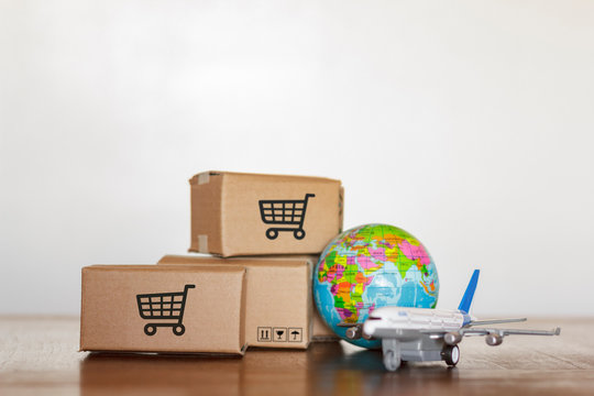 Boxes and plane with planet earth. Shopping worldwide concept