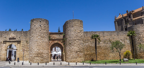 Fototapete - Panorama of the historic city gate of Ronda, Spain