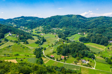 Aerial view of green hills and nature in Zagorje, northern Croatia on sunny summer day