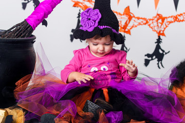 Little girl on Halloween, decor for the holiday. Wall mural