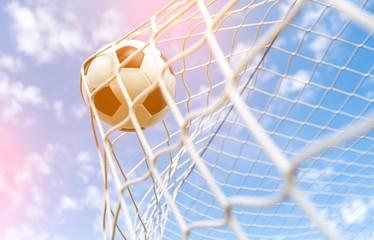 Fototapeta Soccer ball in goal, sport concept