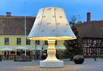 Giant Lamp at Lilla Torg Square with Christmas illumination in twilight on December 15, 2015 in Malmo, Sweden