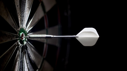 one dart in the center of a dartboard