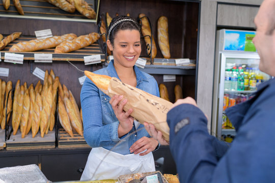 female bakery worker servicing a client
