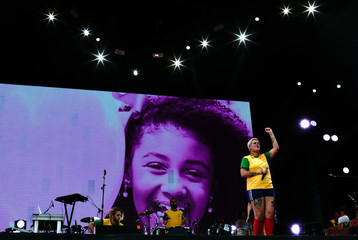 Juliana Strassacapa, the singer of the Brazilian band Francisco, El Hombre reacts in front of the image of eight-year-old Agatha Sales Felix was killed by a stray bullet, at the Alemao complex slum during the Rock in Rio Music Festival in Rio de Janeiro