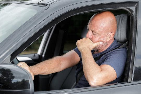 tired man in a car