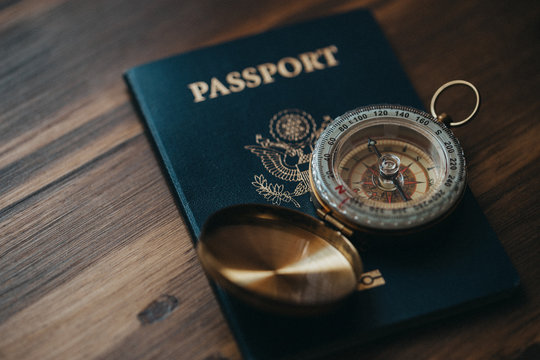 One American passport with a golden compass