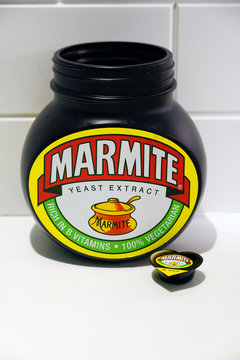 LONDON, ENGLAND -3 APR 2019- View of a jar of Marmite, a traditional British food spread made from yeast extract.