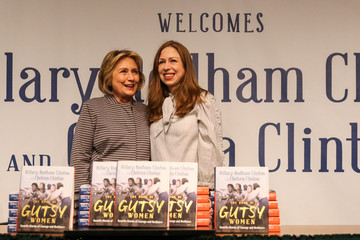 "Hillary Clinton and Chelsea Clinton pose for pictures during an event for their new book ""The Book of Gutsy Women"" in the Manhattan borough of New York City"