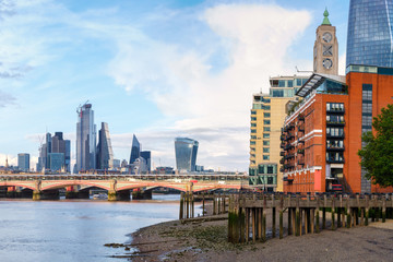 London at sunset with riverside buildings, Blackfriars Bridge and the City