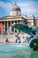 Trafalgar Square in London with the National Gallery on the background