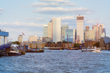 The river Thames in London with Canary Wharf on the background