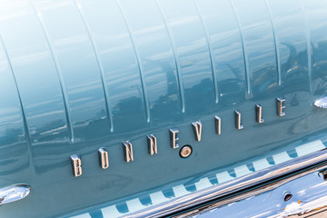 "The rear logo of a classic blue Pontiac Bonneville.  As seen at ""Classics on the Square"", a car show at Celebration Square in Mississauga, Canada on July 6, 2014."
