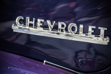 "Chevrolet Advance Design Truck logo on a purple painted model. As seen at ""Classics on the Square"", a car show at Celebration Square in Mississauga, Canada on July 6, 2014."