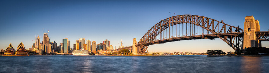 Deurstickers Sydney Sydney Harbour Panoramic with Harbour Bridge and Downtown Skyline. Cruise Ship and Blue Sky water.