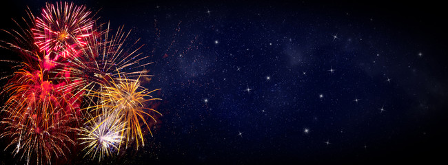 Fireworks on blue background with stars and space for text