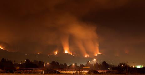 Fire Threatens Homes on Hillside