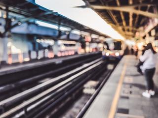 Blurred image of train station before sunset , BTS skytrain at Bangkok