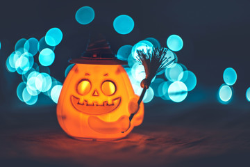 Halloween pumpkin with witch hat and bokeh background