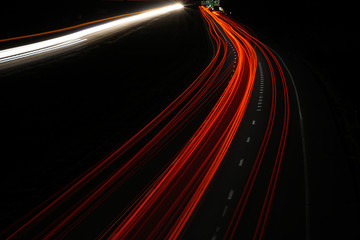 Poster Night highway tail light trails on the highway at night