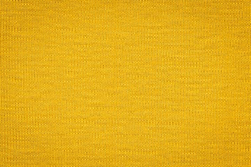 Texture of real yellow knitwear, textile background. Abstract background Wall mural