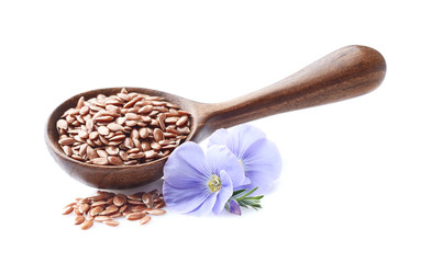 Flax seeds in wooden spoon on white background