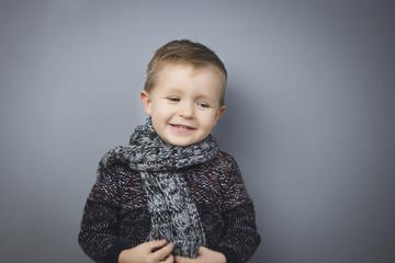 Obraz PORTRAIT OF A BOY WITH SCARF. - fototapety do salonu