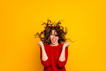 Fototapeta Photo of cheerful ecstatic funny hilarious victorious girlfriend rejoicing with wind blowing at her face isolated over yellow vivid color background obraz