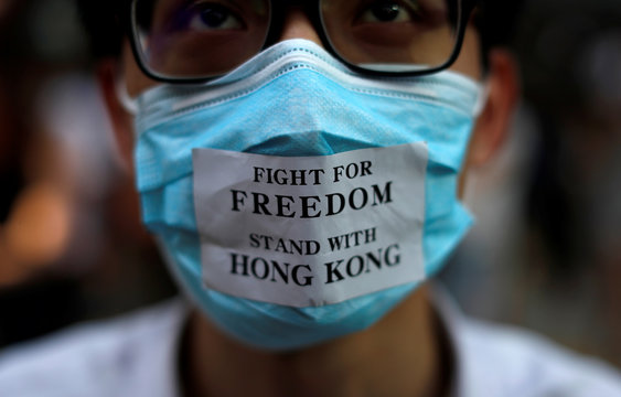 Masked anti-government protesters gather in Central Hong Kong