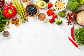 Superfoods on a gray background with copy space