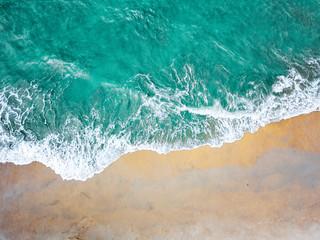 Fotobehang Groen blauw Top view of green turquoise sea water. Capture sea wave and beach in summer.