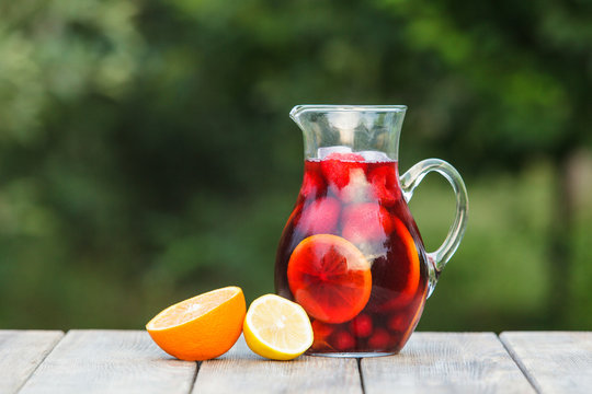 Refreshing sangria or punch with fruits in pincher