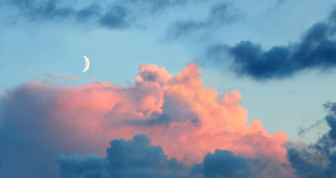 new moon with rose tinted clouds