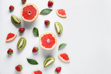 Sweet ripe fruits and berries on white background