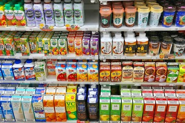 TOKYO, JAPAN - NOVEMBER 29, 2016: Drink shelf of a convenience store in Tokyo, Japan. There are more 42,000 convenience stores in Japan.