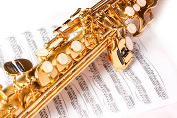 soprano saxophone on white background Fotobehang