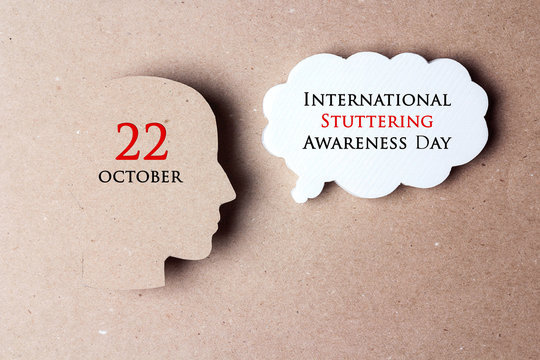 International Stuttering Awareness day, 22 October. Face profile silhouette with speech bubble on a paper brown background.
