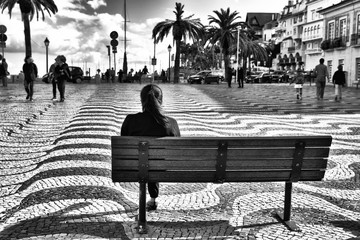 Street photography in black and white at  Main Square of Cascais town, Portugal.