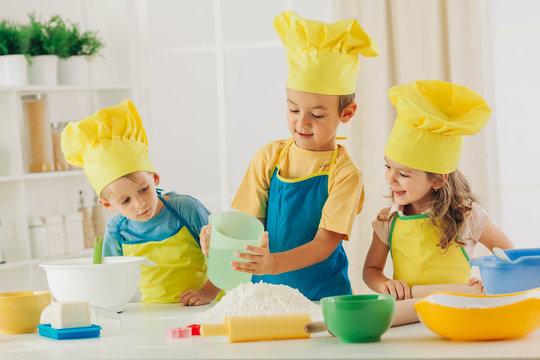 Children having cooking preschool activities