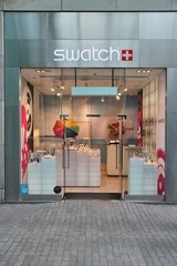 Swatch watch store on April 19, 2013 in Birmingham, UK. Swatch group is a profitable watch manufacturer with profit of 1.074 billion CHF (2010). It employs 24,240 people (2010 average).