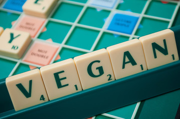 Mulhouse - France - 4 October 2019 - Closeup of plastic letters on Scrabble board game forming the word : vegan