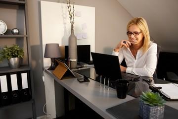 Happy woman using laptop computer