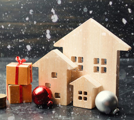 Wooden houses and gifts. Christmas Sale of Real Estate. New Year discounts for buying housing. Purchase apartments at a low price. Winter resort and vacation. Holiday discounts