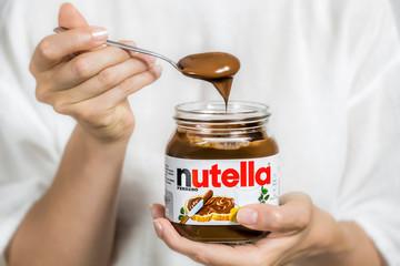 Kiev, Ukraine - Aug 5th, 2017: Chocolate cream in a glass jar Nutella.