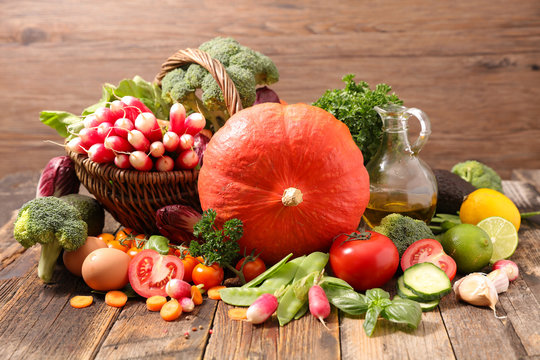selection of autumn vegetable and fruit on wood background