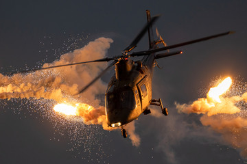 Foto op Canvas Helicopter Military helicopter firing flares